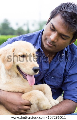Indian men and Labrador in the outdoor garden
