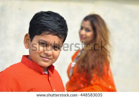 Indian mother and child looking at the camera  - stock photo