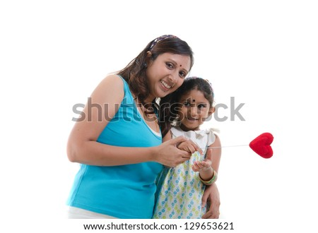 indian mother and daughter during mother's day - stock photo