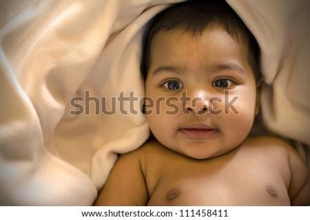indian muslim baby, focus on eyes. shallow dof - stock photo