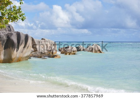Indian Ocean beach and boulders in the Seychelles.Shooting on a sunny clear day. - stock photo