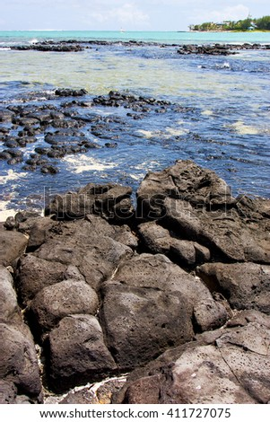 indian ocean some stone in the island of deus cocos in mauritius - stock photo