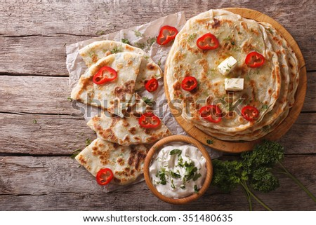 Indian paratha stuffed with potatoes on the table. horizontal view from above - stock photo