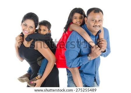 Indian parent piggyback their children - stock photo