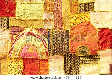 Indian patchwork wall cloth on market, India - stock photo