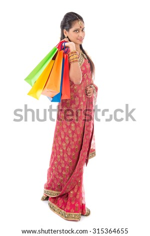 Indian people in traditional sari shopping for diwali festival, full length standing isolated on white background. - stock photo