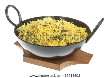 Indian pilau rice with spinach and carrots - stock photo