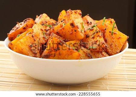 Indian potato curry,go well with ,parathas,chapati and rice.Shallow depth of field photograph. - stock photo