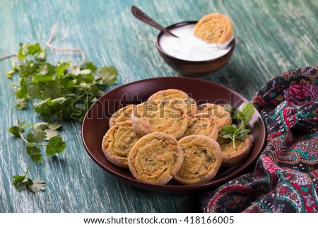 Indian potato rolls with yogurt sauce