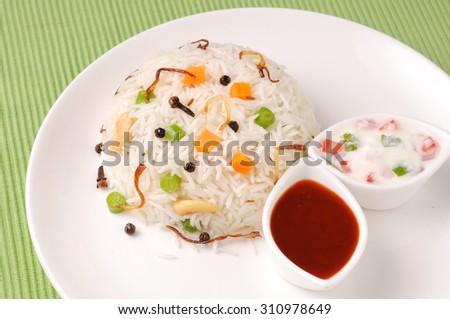 Indian rice dish vegetarian pulao ,Shai Pilau or Vegetable Pilau or Indian Biryani  - stock photo