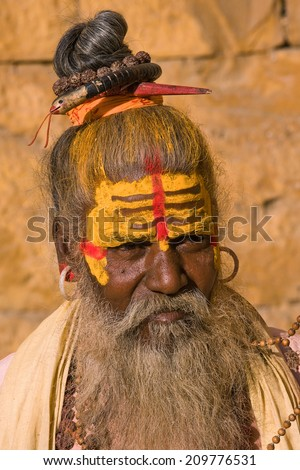 Indian sadhu , holy man in Jaisalmer, Rajasthan, India. - stock photo