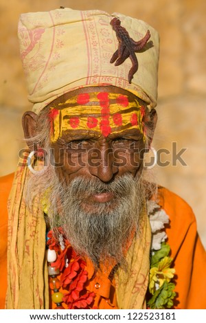 Indian sadhu (holy man). Jaisalmer, Rajasthan, India. - stock photo