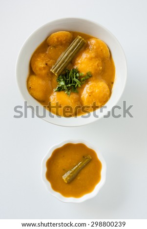 Indian sambar mini idly - A traditional ethnic south Indian breakfast of Sambar Idly (Idli / rice cake) with mini idly in a bowl of sambar with drumstick and cilantro as garnish. Natural light used. - stock photo
