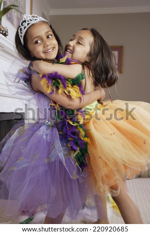 Indian sisters wearing costumes - stock photo