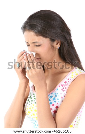 Indian slim girl sneezing with tissue paper - stock photo
