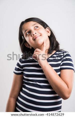 indian small girl thinking, cute asian girl thinking and looking up - stock photo
