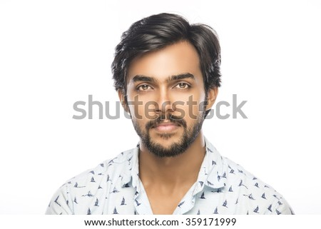 Indian smart young man portrait on white background. - stock photo