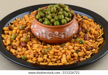 Indian Snack : Mixture and Spiced fried green peas {chatpata matar}. - stock photo
