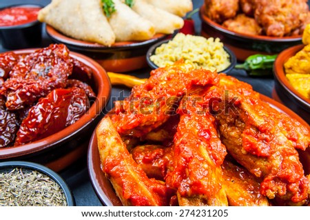 Indian snacks in bowls - stock photo