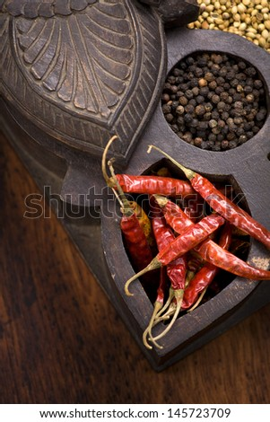 Indian spices | chili, coriander, pepper and turmeric in masala dani, spice box - stock photo