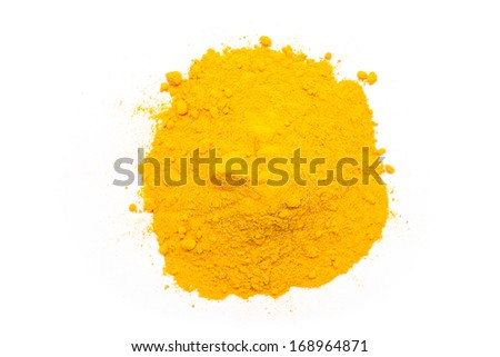Indian Spices Of Turmeric Powder Pile On White Background - stock photo
