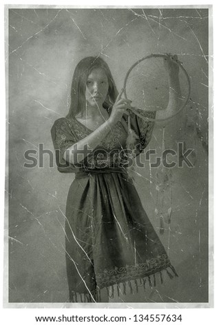 Indian Squaw Girl In Traditional Wear And Dream Catcher Posing To The Camera Vintage