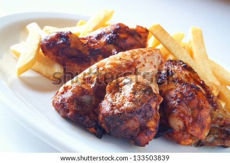 Indian style barbecue chicken with potato fries - stock photo