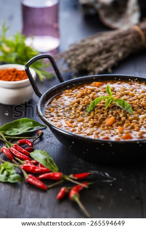 Indian style lentil soup with red hot chili pepper - stock photo
