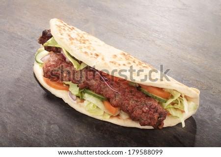 Indian style shish kofta kofte naan donner kebab sandwich - stock photo