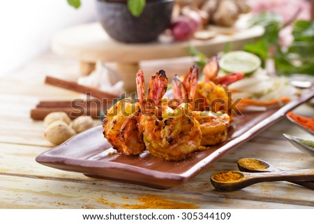indian tandoori prawn spiced up with herbs and then grilled in tandoor - stock photo