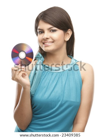 indian teenage girl holding the cd in her right hand - stock photo