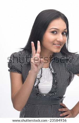 Indian teenage girl showing two fingers