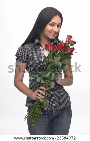 indian teenage girl with red roses - stock photo