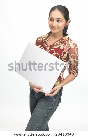 Indian teenage girl with white placard - stock photo