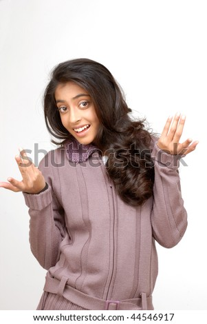 indian teenager girl shrug her shoulder in wonder gesture