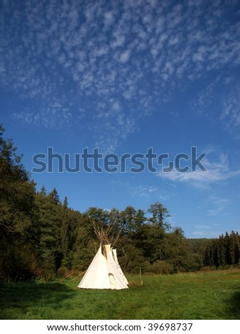 indian teepees with blue sky - stock photo