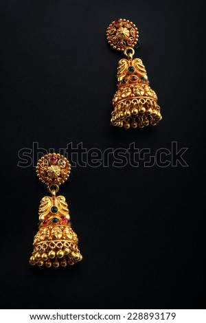 Indian Traditional Gold Earrings - stock photo