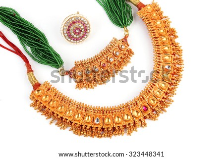 Indian Traditional jewellery necklace & Forehead Rakhadi isolated on white - stock photo