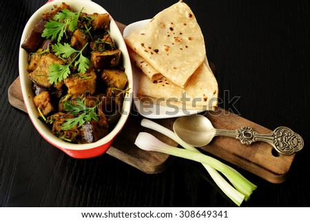 Indian Vegetable and Chapati - Homemade chapati (Indian bread) served with delicious Eggplant vegetable curry. Rural food concept. - stock photo