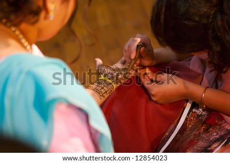Indian wedding bride getting henna applied - stock photo