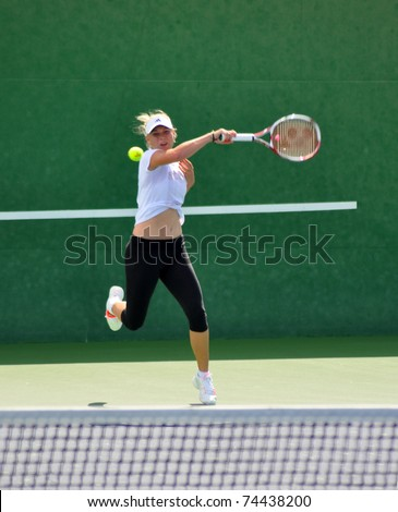 INDIAN WELLS, CA - MARCH 15.  Denmark's Caroline Wozniacki warms up on the practice court March 15, 2011 at the BNP Paribas Open.