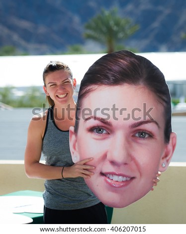 INDIAN WELLS, UNITED STATES - MARCH 9 : Simona Halep poses with a cut-out head of herself at the 2016 BNP Paribas Open All Access Hour
