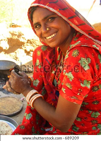 Indian Woman cooking chapati - stock photo