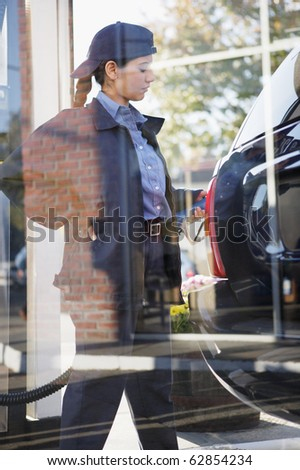 Indian Woman Gas Station Attendant Pumping Gas Stock Photo