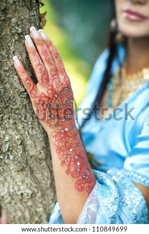 indian woman hand with henna. Details from a hindu wedding - stock photo