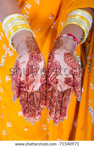 indian woman hands with henna - stock photo