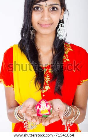 indian woman holding a statue - stock photo