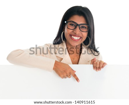 Indian woman holding and pointing to blank billboard. Portrait of attractive young Asian female model isolated on white background. - stock photo