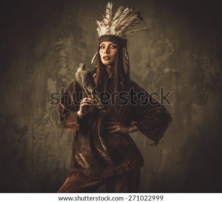 Indian woman hunter with  pet hawk  - stock photo