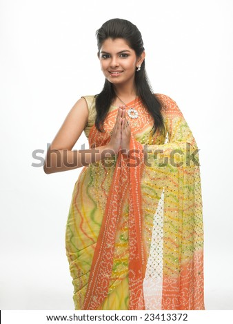 Indian woman in a tradition sari with welcome expression - stock photo